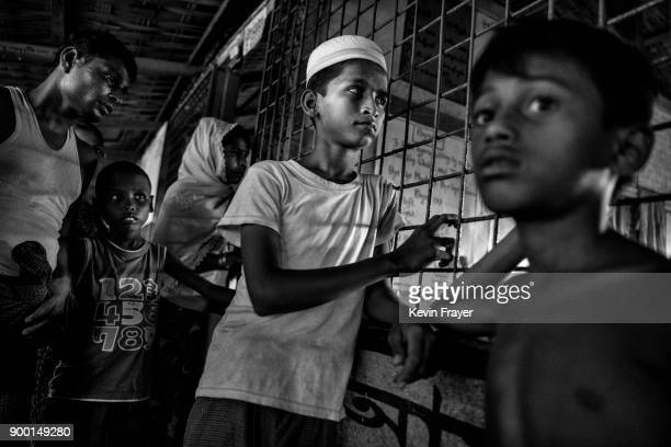 COX'S BAZAR BANGLADESH OCTOBER 27Rohingya Muslim refugees rest inside a local school being used as a temporary shelter for new arrivals on October 27...