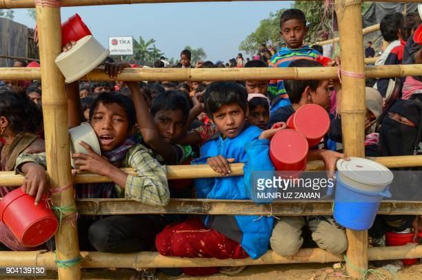 TOPSHOT Rohingya Muslim refugees wait for food aid at Thankhali refugee camp in Bangladesh's Ukhia district on January 12 2018 About 655000 Rohingya...