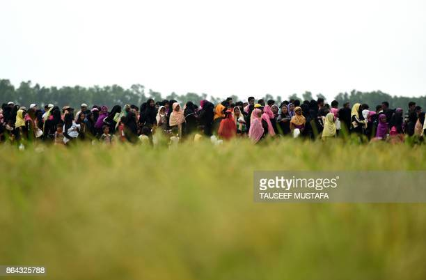 Rohingya Muslim refugees wait for relief aid at Nayapara refugee camp in Teknaf on October 21 2017 Thousands of Rohingya Muslims stranded near...