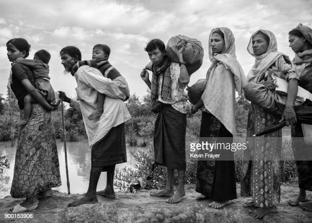 COX'S BAZAR BANGLADESH NOVEMBER 02 Rohingya Muslim refugees wait to proceed after crossing the border from Myanmar into Bangladesh close to the Naf...
