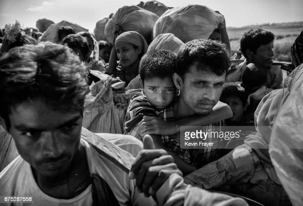 COX'S BAZAR BANGLADESH NOVEMBER 03 Rohingya Muslim refugees waiting to proceed to camps after crossing the border from Myanmar into Bangladesh crowd...