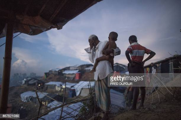 Rohingya Muslim refugees watch the hundreds of tents at Balukhali refugee camp in Bangladesh's Ukhia district on October 4 2017 More than 500000...