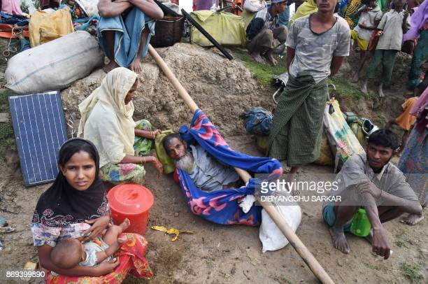 Rohingya Muslim refugees who had been stranded in the 'noman's land' between Myanmar and Bangladesh wait to enter Palongkhali in Bangladesh's Ukhia...