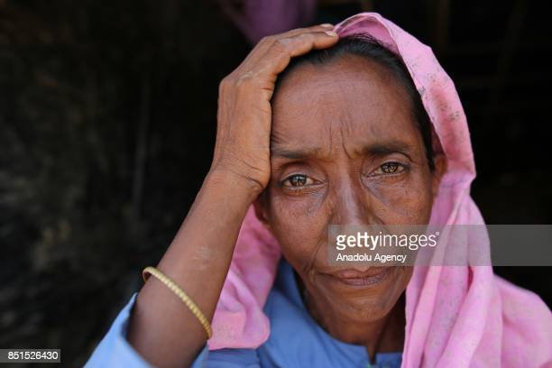 Rohingya Muslim woman, fled from ongoing military operations in Myanmars Rakhine state, poses for a photograph at a makeshift camp in Teknaff,...