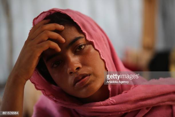 Rohingya Muslim woman, fled from ongoing military operations in Myanmars Rakhine state, poses for a photograph in a tent at a makeshift camp in...