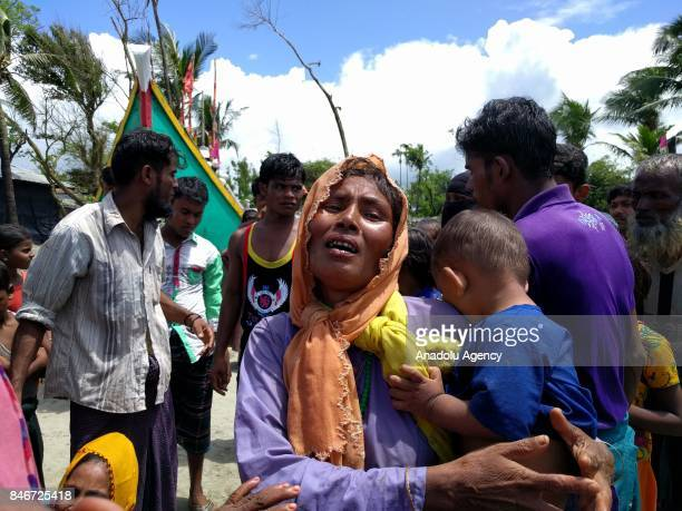 Rohingya Muslim woman fled from ongoing military operations in Myanmars Rakhine state gestures after her child died and many other left wounded in a...