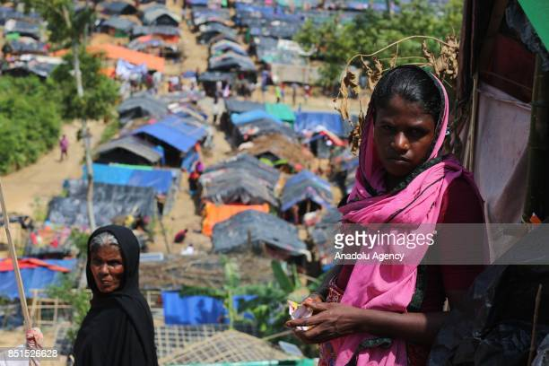 Rohingya Muslim women, fled from ongoing military operations in Myanmars Rakhine state, pose for a photograph near a tent at a makeshift camp in...