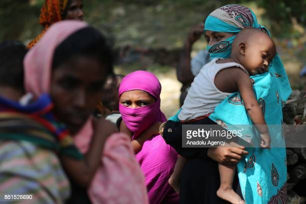 Rohingya Muslim women, fled from ongoing military operations in Myanmars Rakhine state, are seen at a makeshift camp in Teknaff, Bangladesh on...