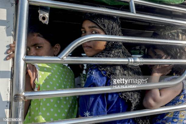 TOPSHOT Rohingya Muslim women ride a police vehicle in Kyauktan township south of Yangon on November 16 2018 after their boat washed ashore A...