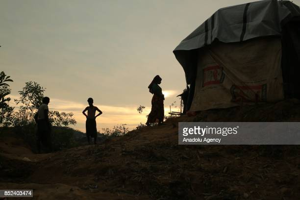 Rohingya Muslims are seen during sunset at a makeshift camp in Teknaff Bangladesh on September 23 2017 Violence erupted in Myanmars Rakhine state on...
