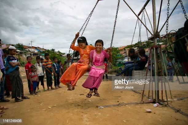 COX'S BAZAR BANGLADESH AUGUST 12 Rohingya Muslims celebrate at a fair during Eid alAdha in a refugee camp August 12 2019 in Cox's Bazar Bangladesh...