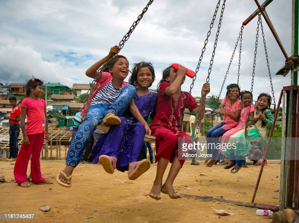 COX'S BAZAR BANGLADESH AUGUST 12 Rohingya Muslims celebrate at a fair during Eid alAdha in a refugee camp August 12 2019 in Cox's Bazar Bangladesh...