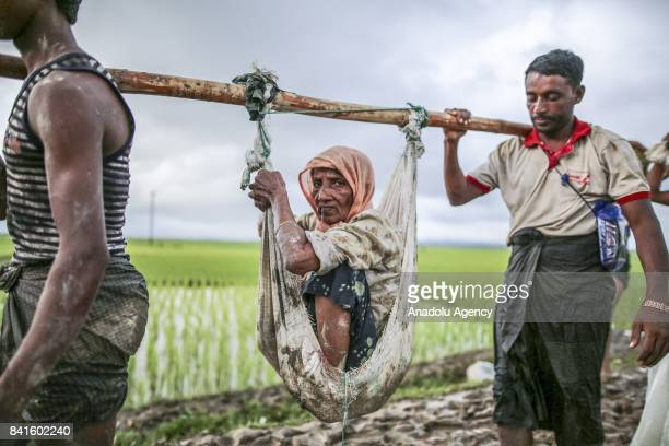 COX'S BAZAR BANGLADESH SEPTEMBER 01 Rohingya Muslims fled from ongoing military operations in Myanmars Rakhine state make their way through muddy...