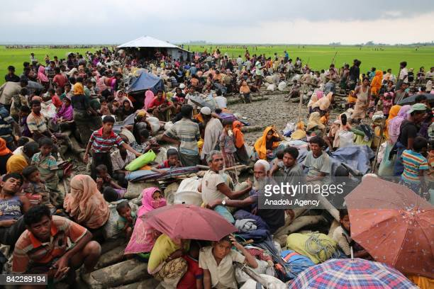 COX'S BAZAR BANGLADESH SEPTEMBER 03 Rohingya Muslims fled from ongoing military operations in Myanmars Rakhine state make their way through muddy...