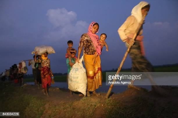 COX'S BAZAR BANGLADESH SEPTEMBER 05 Rohingya Muslims fled from ongoing military operations in Myanmars Rakhine state walk towards Bangladesh after...