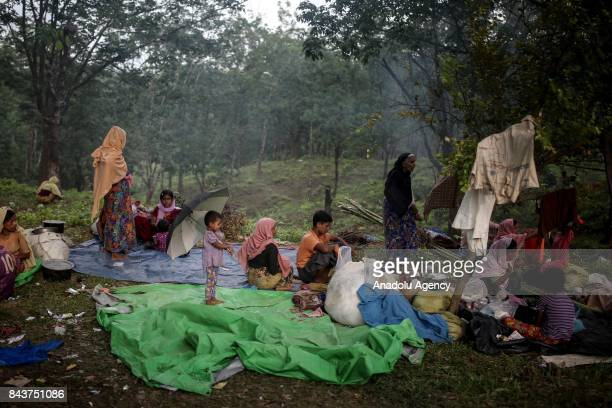 COX'S BAZAR BANGLADESH SEPTEMBER 07 Rohingya Muslims fled from ongoing military operations in Myanmars Rakhine state sit on tarps laid on the floor...