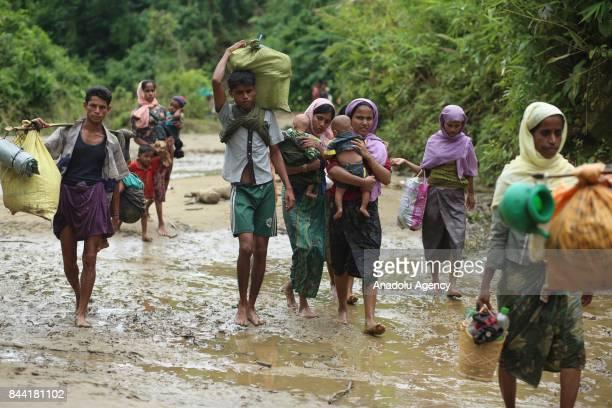 COX'S BAZAR BANGLADESH SEPTEMBER 08 Rohingya Muslims fled from ongoing military operations in Myanmars Rakhine state walk towards Bangladesh through...