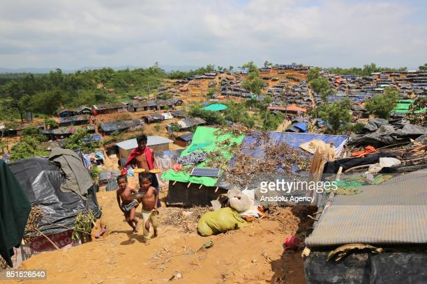 Rohingya Muslims, fled from ongoing military operations in Myanmars Rakhine state, are seen near a tent at a makeshift camp in Teknaff, Bangladesh on...