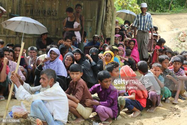 Rohingya Muslims, fled from ongoing military operations in Myanmars Rakhine state, sit on the ground at a makeshift camp in Teknaff, Bangladesh on...
