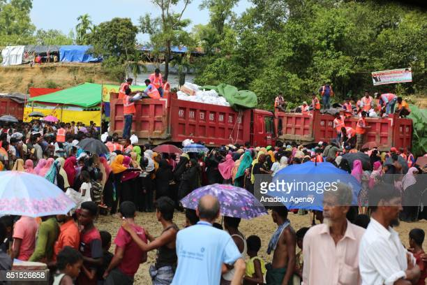 Rohingya Muslims, fled from ongoing military operations in Myanmars Rakhine state, gather to receive humanitarian aids at a makeshift camp in...