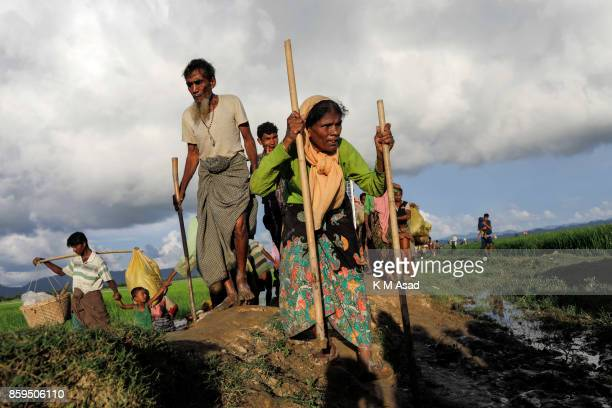 Rohingya people crossing Bangladesh's border as they flee from Buchidong at Myanmar after crossing the Naf River in Bangladesh According to the...