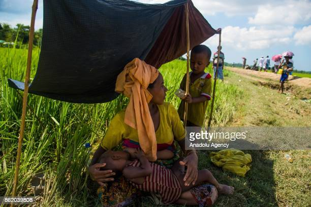 COX'S BAZAR BANGLADESH OCTOBER 16 Rohingya people fled from ongoing military operations in Myanmars Rakhine state cross the border in Palongkhalii of...