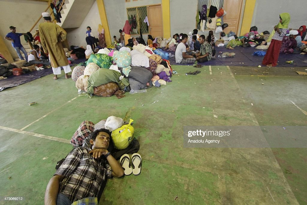 Rohingya people from Bangladesh and Myanmar take rest at shelter at Matang Raya village on May 12, 2015 in Northern Aceh, Aceh, Indonesia. 573 Rohingya from Bangladesh and Myanmar were found stranded by Aceh fishermen on North Aceh sea. Rohingya were going to Malaysia with dozens of children and women.