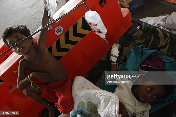 Rohingya people receive medical treatment at temporary shelter on May 17 2015 in Langsa Aceh Indonesia Indonesia is reported to be sheltering around...