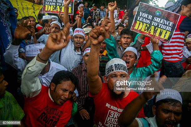 Rohingya people shout and show a placard during a demonstration near the Myanmar Embassy against the ethnic cleansing of Rohingya in Myanmar's...