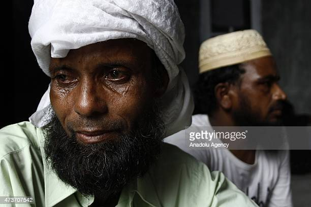 Rohingya people take rest at temporary shelter on May 17 2015 in Langsa Aceh Indonesia Indonesia is reported to be sheltering around 1486 boat people