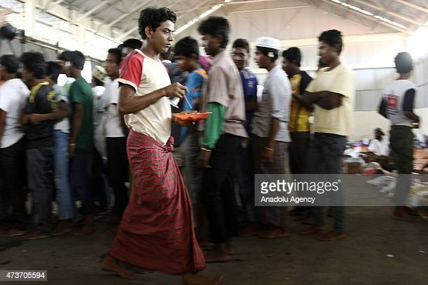 Rohingya people wait in food queue at temporary shelter on May 17 2015 in Langsa Aceh Indonesia Indonesia is reported to be sheltering around 1486...
