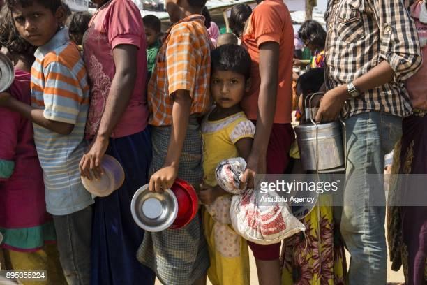COX'S BAZAR BANGLADESH DECEMBER 19 Rohingya people wait in line to receive food aid at Kutupalong refugee camp in Maynar Guna near Cox's Bazar...