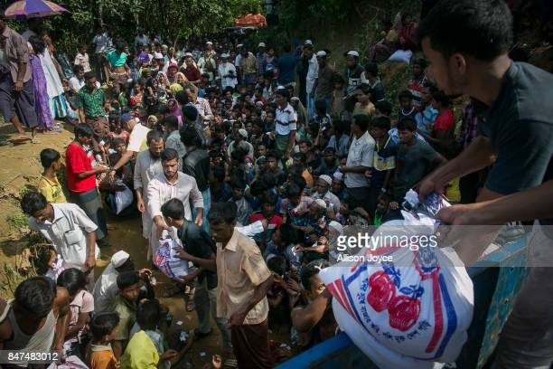 Rohingya receive donations in an informal settlement September 15 2017 in Cox's Bazar Bangladesh Nearly 400000 Rohingya refugees have fled into...