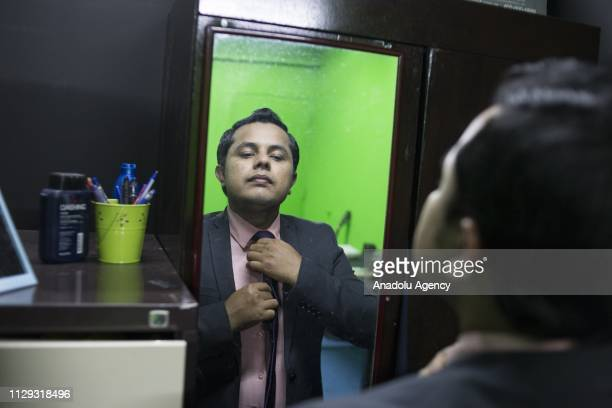Rohingya refugee Ajmeer Omar the main anchor of the channel prepares ahead of the recording session at Rohingya Vision TV studio in Kuala Lumpur...