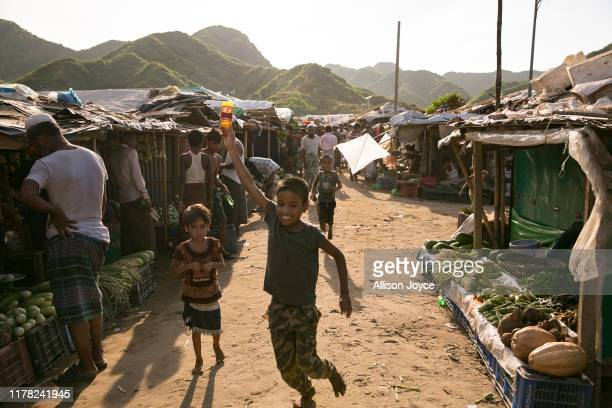 Rohingya refugee boy flies a kite in a refugee camp on October 26, 2019 in Cox's Bazar, Bangladesh. Bangladesh officials have said that between...