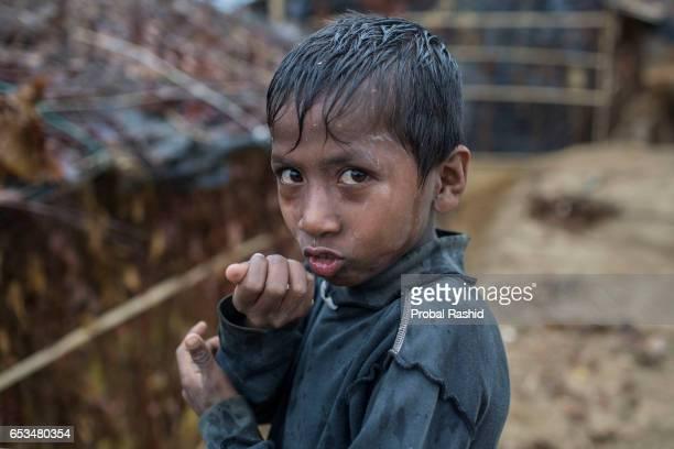 COX'S BAZAR BANGLADESH COX'S BAZAR CHITTAGONG BANGLADESH A Rohingya refugee boy stands in Kutupalong refugee camp on March 06 Cox's Bazar Bangladesh