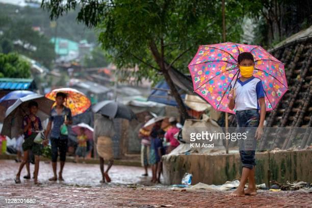 Rohingya refugee boy ware facemask at the Kutupalong Rohingya refugee camp in Ukhiya. Around a million Rohingya refugees stuck in Bangladesh marked...