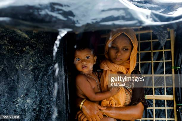Rohingya refugee boy with his mother in their makeshift tent at Ukhiya Cox's Bazar According to the UNHCR more than 500000 Rohingya refugees have...