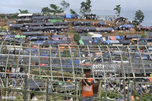 TOPSHOT Rohingya refugee buils a new makeshift shelter in the refugee camp of Thyangkhali near the Bangladeshi village of Gumdhum on September 18...