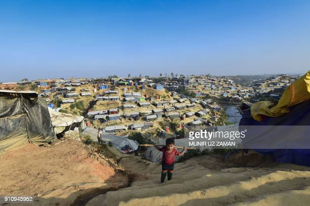 Rohingya refugee child climbs stairs at Hakimpara refugee camp in Bangladesh's Ukhia district on January 27 2018 The repatriation of hundreds of...