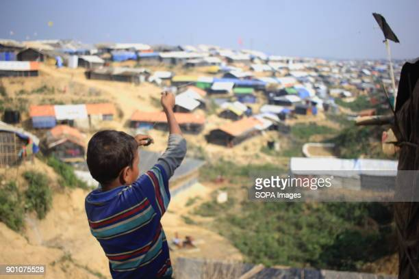 A Rohingya refugee child seen flying a kite at the refugee camp More than 600000 Rohingya refugees have fled from Myanmar Rakhine state since August...