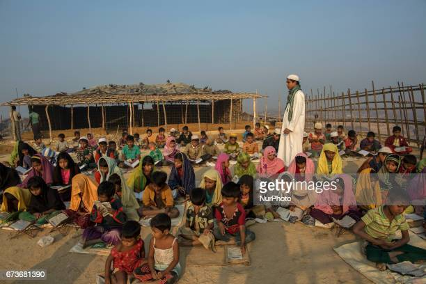 Rohingya refugee children attend an open air Arabic school in Kutupalang newly expanded Refugee Camp where they learn to read the Quran Approximately...