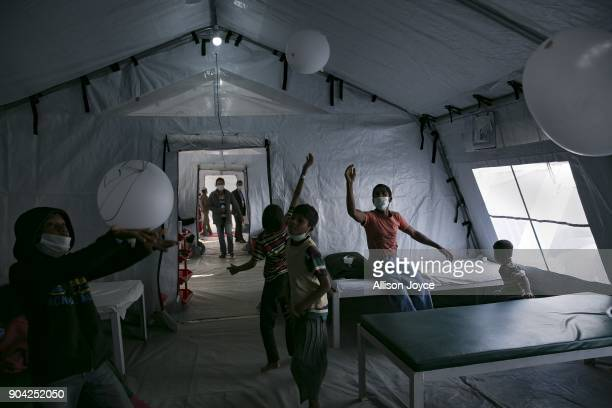 COX'S BAZAR BANGLADESH JANUARY 12 Rohingya refugee children play with glove balloons at a Samaritan's Purse diphtheria clinic in Balukhali camp on...