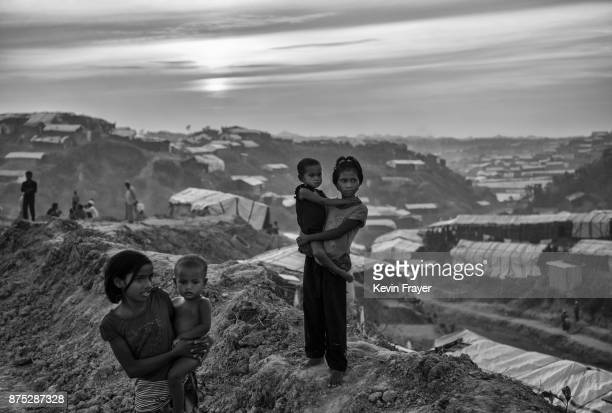 COX'S BAZAR BANGLADESH OCTOBER 28 Rohingya refugee children stand on a new road being built on October 28 2017 at the Balukhali refugee camp near...