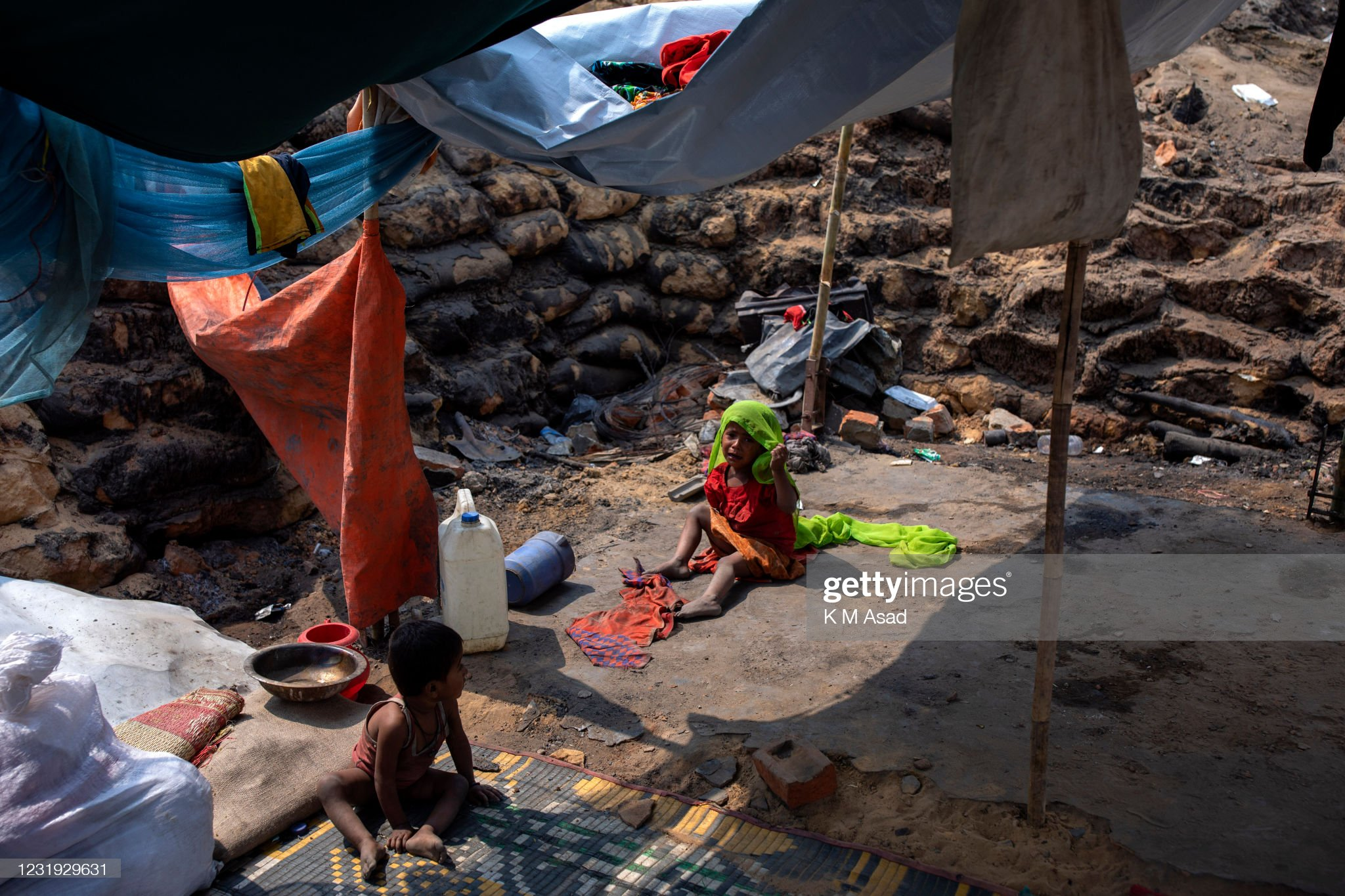 Rohingya refugee children under a temporary shelter after a... : News Photo