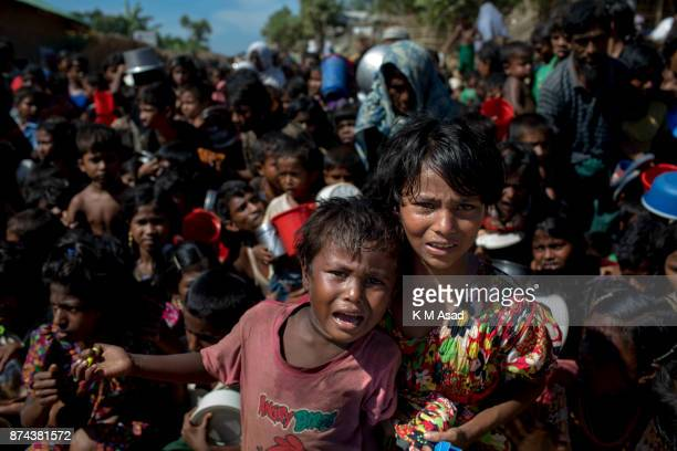 Rohingya refugee childrens wait in front of a food distribution center at Thankhali Rohingya refugee camp in Ukhia district Coxsbazar Bangladesh on...