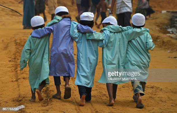 TOPSHOT Rohingya refugee childrens walk at Moynerghona refugee camp in the Bangladeshi district of Ukhia on October 29 2017 Bangladesh is planning to...