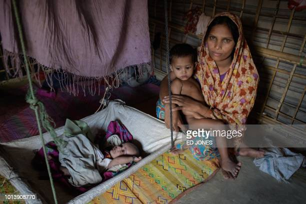 Rohingya refugee Dola Banu who arrived in Bangladesh from the Cho Par Bushidong area of Myanmar in September 2017 poses for a photo with her son and...