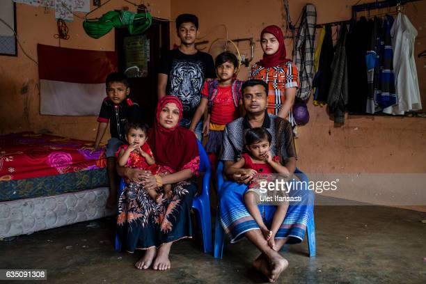 Rohingya refugee family Muhammad Rofiq and his wife Hamidah with their children pose for photograph inside of their refugee camp on February 12 2017...