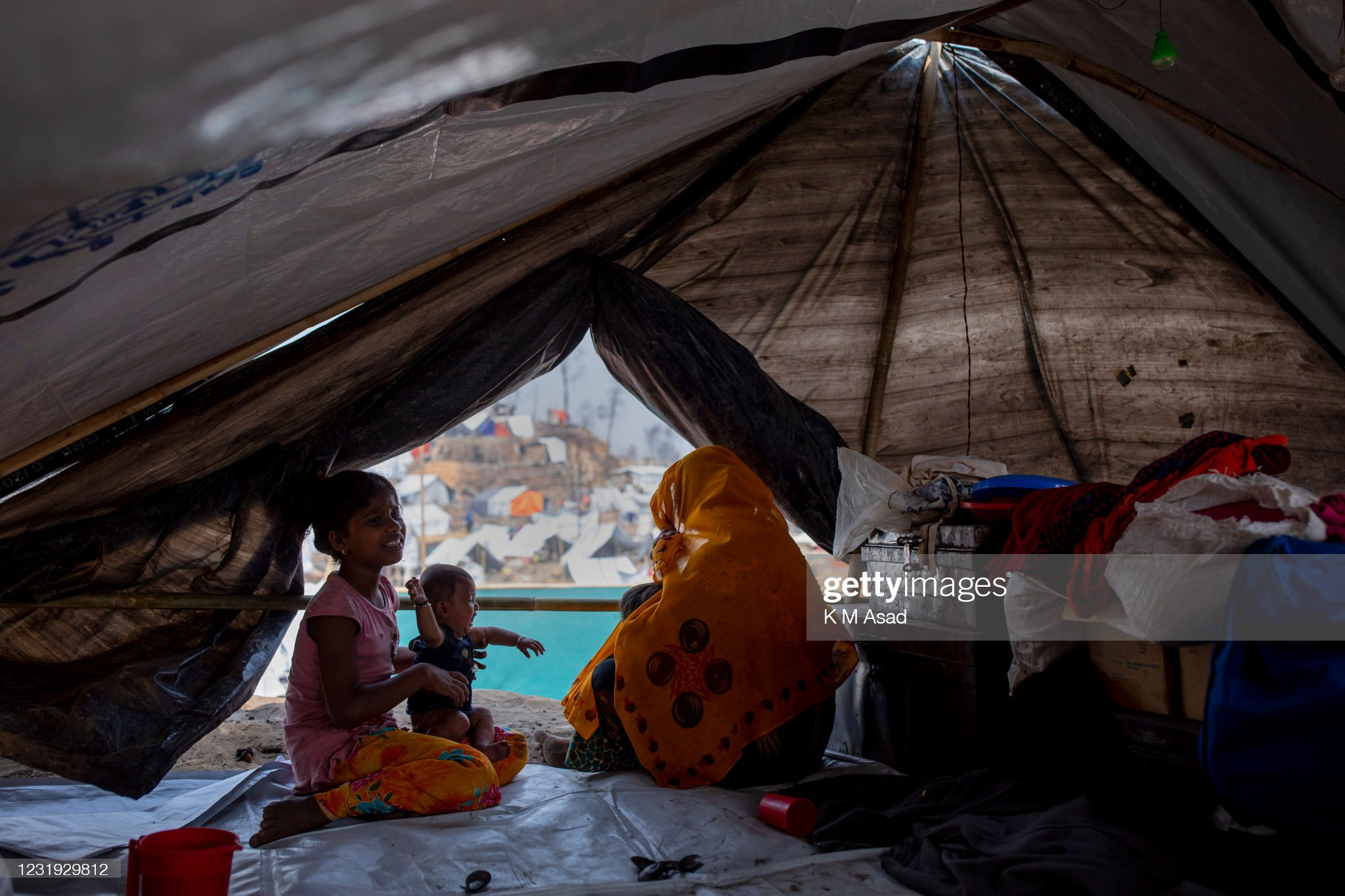 Rohingya refugee family under a temporary shelter after a... : News Photo